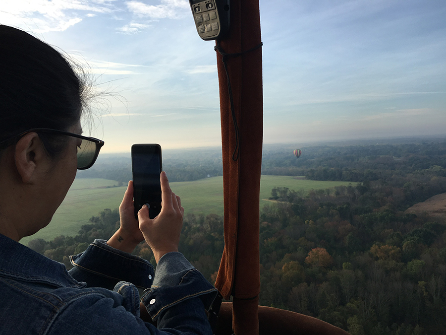 taking photo from hot air balloon
